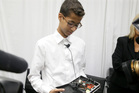 Ahmed Mohamed shows the clock he built in a school pencil box to reporters after a news conference in Dallas. Photo / AP
