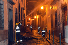 Firefighters battle a fire that reached the old centre of Funchal, the capital of Portugal's Madeira Island. Photo / AP
