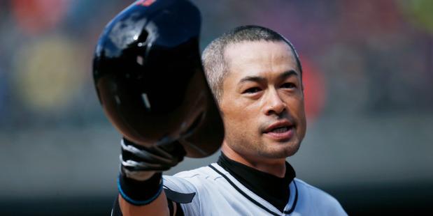 Miami Marlins' Ichiro Suzuki tips his batting helmet to the crowd after his 3,000th career hit. Photo / AP
