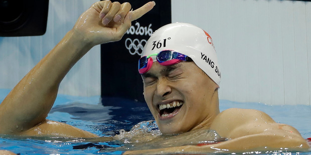 Loading China's Sun Yang celebrates winning the final of the men's 200-meter freestyle during the swimming competitions at the 2016 Summer Olympics. Photo / AP