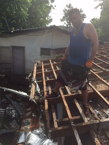 Dannevirke EIT graduate James Gilbert (Cookie), working on reconstructing a cyclone-damaged roof on a doctor's centre on the island of Tanna, 200 kilometres south of Port Vila,  Vanuatu.