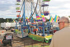 Law enforcement cordon off the area surrounding the Ferris wheel after three people fell from the ride during a county fair in Tennessee. Photo / AP