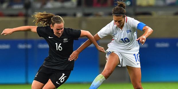 Football Fern's Annalie Longo challenges Carli Lloyd (USA). Photo / AP.