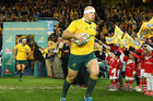 Australia captain Stephen Moore leads the Wallabies onto the field against England in June earlier this year. Photo / Getty Images