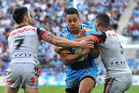 Jarryd Hayne of the Titans takes on the defence in his first run and first match for the club. Photo / Getty