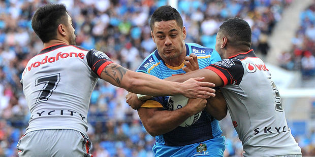 Loading Jarryd Hayne is tackled by the Warriors defence. Photo / Getty