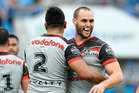 Simon Mannering of the Warriors celebrates victory with his team mates against the Titans. Photo / Getty Images