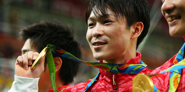 Gymnast Kohei Uchimura of Japan poses for photographs with the gold medal. Photo / Getty Images