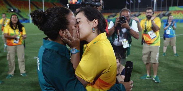 Volunteer Marjorie Enya (R) and rugby player Isadora Cerullo of Brazil kiss after proposing marriage. Photo / Getty Images