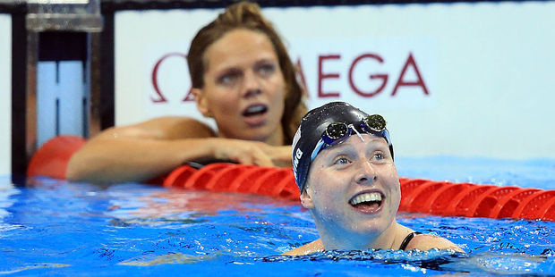 Lilly King celebrates winning gold as rival Yulia Efimova settles for silver. Photo / Getty