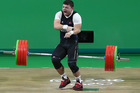Andranik Karapetyan of Armenia was injured during the Men's 77kg Group A weightlifting contest. Photo / Getty Images