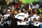 Fiji players and staff huddle as they win gold after the Men's Rugby Sevens. Photo / Getty