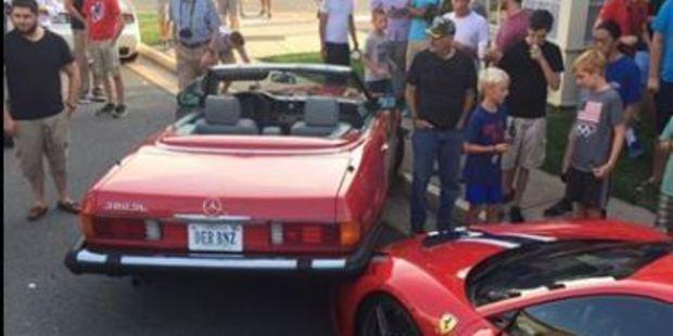 Loading The back of the Mercedes became hoisted on the Ferrari. Photo / Instagram