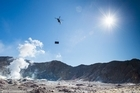 The New Zealand Defence Force (NZDF) has airlifted a 2.4-tonne shipping container to volcanic White Island near Whakatane, to provide visitors an emergency shelter in case of an eruption. Check out the action unfold here + interviews