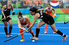 Women's Black Sticks captain Kayla Whitelock, right, secured a 1-1 draw with the Netherlands with a stunning second half goal. Photo / AP