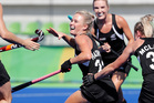 New Zealand's Charlotte Harrison celebrates with teammates after scoring against South Korea during their opening group game of the Olympics. Photo / AP