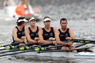 Nathan Flannery, John Storey, George Bridgewater, and Jade Uru row to shore after bowing out of the men's quadruple sculls. Photo / AP