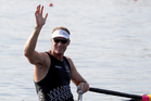 Mahe Drysdale waves after winning his heat in the men's single sculls at the Rio Olympics. Photo / AP