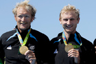 Eric Murray and Hamish Bond with their gold medals. Photo / AP