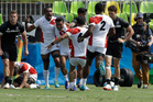 Japan's players celebrate after winning the men's rugby sevens match against New Zealand at the Summer Olympics in Rio de Janeiro. Photo / AP