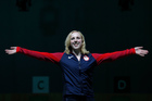 Virginia Thrasher of the United States celebrates winning the first gold medal of the 2016 summer Olympics. Photo / AP