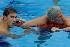 Michael Phelps wins the gold medal in the men's 200-meter individual medley ahead of fifth placed Ryan Lochte - but not according to the commentator. Photo / AP