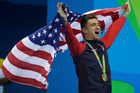United States' Anthony Ervin celebrates his gold medal for the men's 50-meter freestyle final. Photo / AP