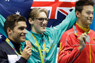 Australia's gold-medal winning swimmer Mack Horton, centre, has come under fire from Chinese swimming fans after he labeled Sun Yang, right, a