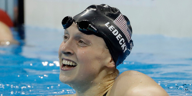 United States' Katie Ledecky celebrates winning the gold medal in the women's 200-metre freestyle at the 2016 Summer Olympics. Photo / AP
