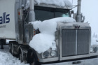 A truck stuck on the summit of the Napier Taupo Road SH5 following heavy snow. Photo / Rebecca Hodgetts