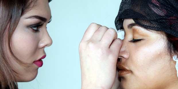 FINAL TOUCHES: A stylist puts the finishing touches to a model's make-up. PHOTO/BEVAN CONLEY