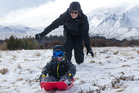 Luke with mum Enesta as they enjoy some tobogganing at the base of Mt Ruapehu. Photo / Alan Gibson