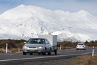 Vehicles travel past a winter wonderland on State Highway 47 at the base of Mt Ruapehu today. Photo / Alan Gibson