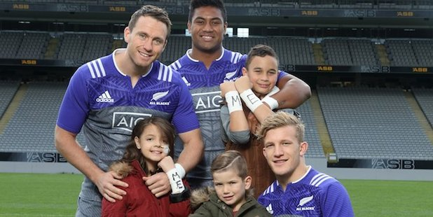 All Blacks and the three ambassador children featured in the Cure Kids campaign. (L-R) All Blacks Ben Smith, Julian Savea and Damian McKenzie with Eva, Finn and Kemper. Photo / Supplied