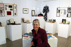 Diane Harries, curator of the Poetics exhibition, with works by Yoka van Dyk. PHOTO/STUART MUNRO