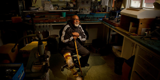 LOOKING FORWARD: QE helps Fijian polio victim Reggie Kumar who is looking forward to his new leg. PHOTO/STEPHEN PARKER