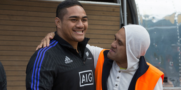 Ofa Tu'ungafasi poses for a photo with a fan during the All Blacks signing session at Aotea Square. Photo / Brett Phibbs