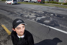 CONCERN: Hayley Raethel is concerned about the potholes on Te Ngae Rd near the Tarawera roundabout. PHOTO/BEN FRASER