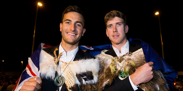 Four-time world champion sailors Blair Tuke and Peter Burling were presented with a traditional kakahu by the New Zealand Olympic Team Chef de Mission Rob Waddell. Photo / Photosport NZ