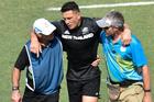 New Zealand's Sonny Bill Williams is taken injured from the field. Photo / photosport.nz