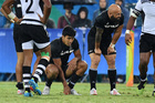 New Zealand's DJ Forbes (R with team mate Rieko Ioane) sit dejected after a call by the ref went against them during day two of the Men's rugby sevens New Zealand vs Fiji. Photo / Photosport.co.nz