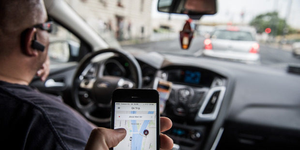 The internet is making many activities safer, and Uber is no exception. Its app provides regular checks on where the vehicle is and the route it is taking. Photo / NZ Herald