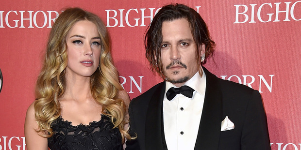 Amber Heard and Johnny Depp announced their divorce in May this year. Photo / AP