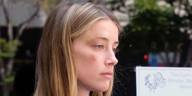Actress Amber Heard was granted a temporary restraining order against Depp in May. . Photo / AP