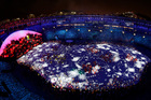 One way Brazil kept the costs down for the opening ceremony was by using projection rather than reality, though real human stars did figure as well. Photo / AP/Morry Gash