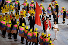 Sheng Lei carries the flag of China during the opening ceremony for the 2016 Rio Olympics. Photo / AP
