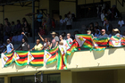 Zimbabweans wave flags during the 36th over of the test cricket match between New Zealand and Zimbabwe in Bulawayo. Picture / AP