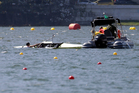 Milos Vasic and Nenad Bedik, of Serbia, are helped out of the water after capsizing while competing in the men's pair heat during the 2016 Summer Olympics in Rio de Janeiro. Photo / AP.