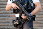 Police stand guard near where two policewomen were attacked with a machete in Charleroi, Belgium, on Saturday. Photo / AP