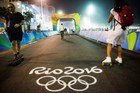 The Olympic rings decorate the finish line of the cycling road race. Photo / AP
